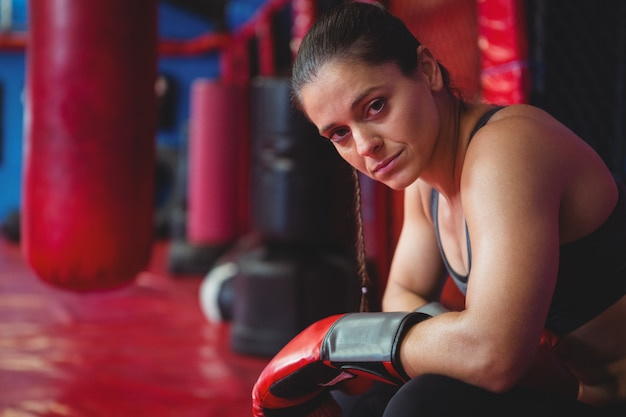 Female boxer posing with boxing gloves