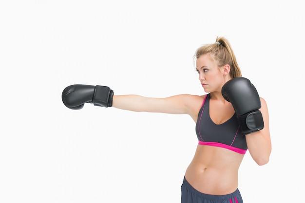 Female boxer punching