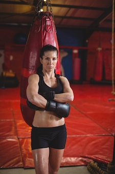 Female boxer standing with arms crossed