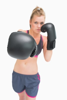 Female boxer stretching arm out