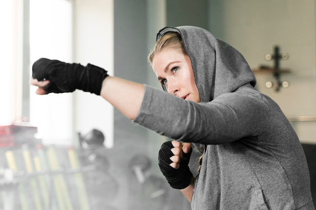 Female boxer training alone for a new competition