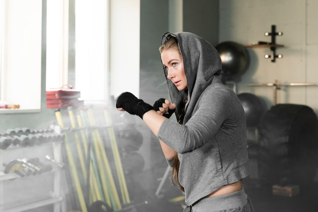Female boxer training for a new competition with copy space