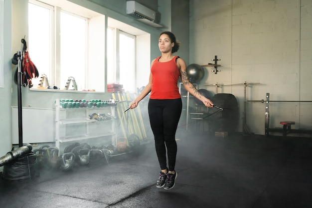 Female boxer training with a jumping rope