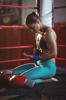 Female boxer wearing blue strap on wrist