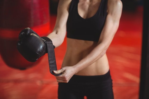 Female boxer wearing boxing gloves