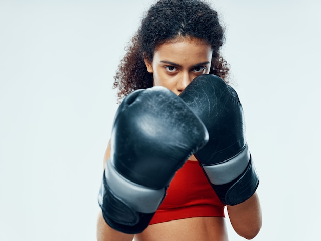 Female boxer with boxing gloves.