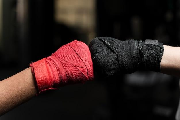 Female boxers training gloves close-up