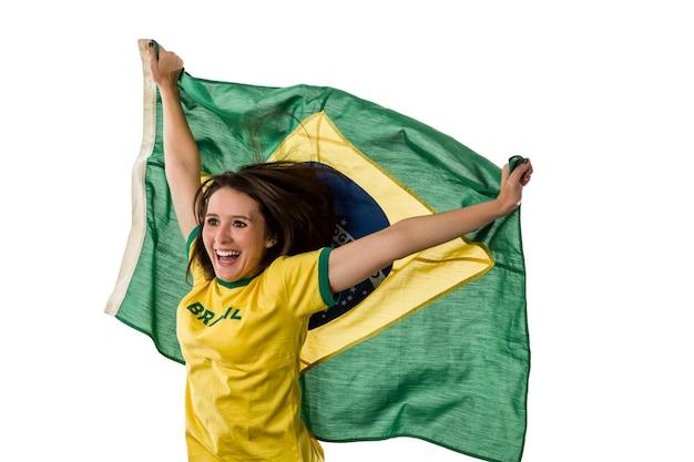 白いスペースで祝う女性のブラジルのファン。