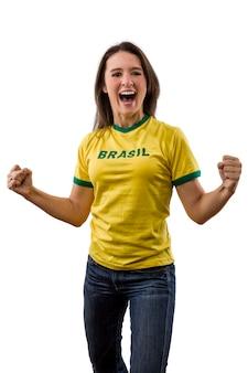 Female brazilian fan celebrating on a white space.