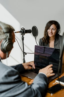 Female broadcaster interviewing her guest in a studio