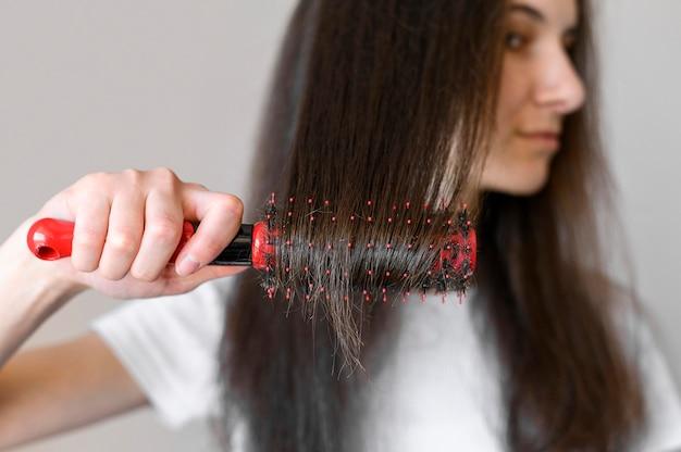 Female brushing hair