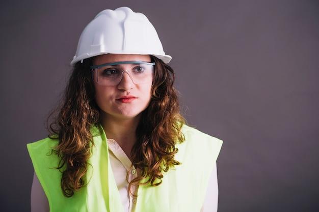 Female builder in helmet