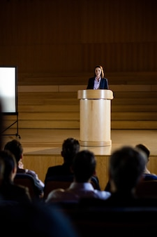 Female business executive giving a speech
