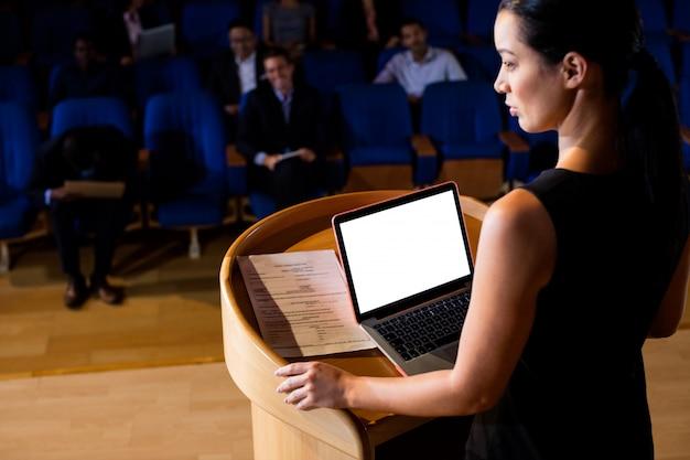 Female business executive giving a speech