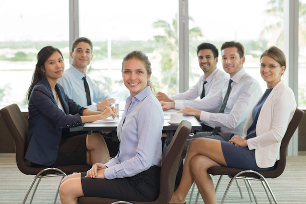Female business leader and team in office