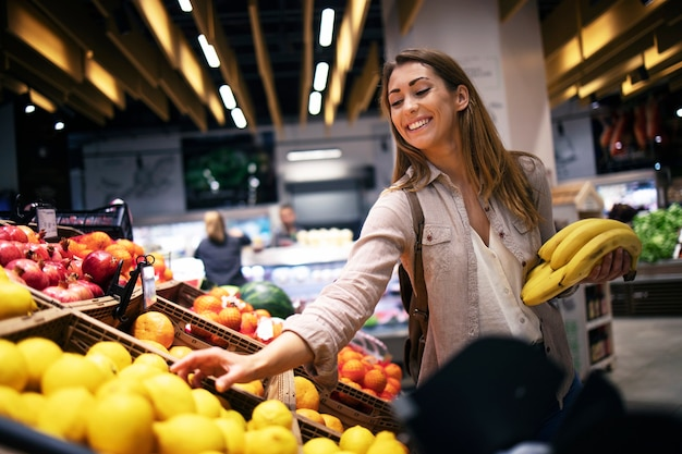 Female buying food at supermarket grocery store