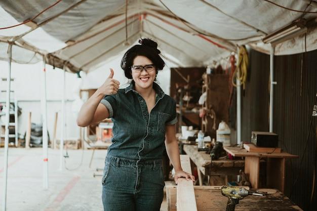 Female carpenter in her wood shop