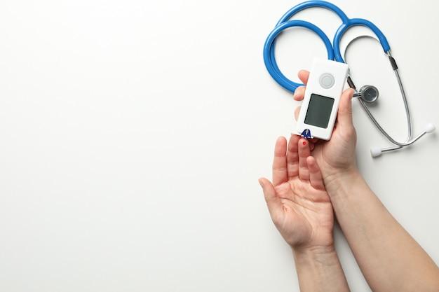 Female checking blood sugar level