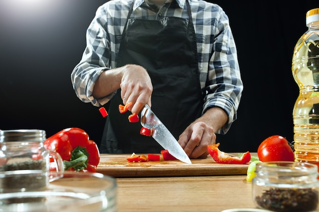 Female chef cutting fresh vegetables