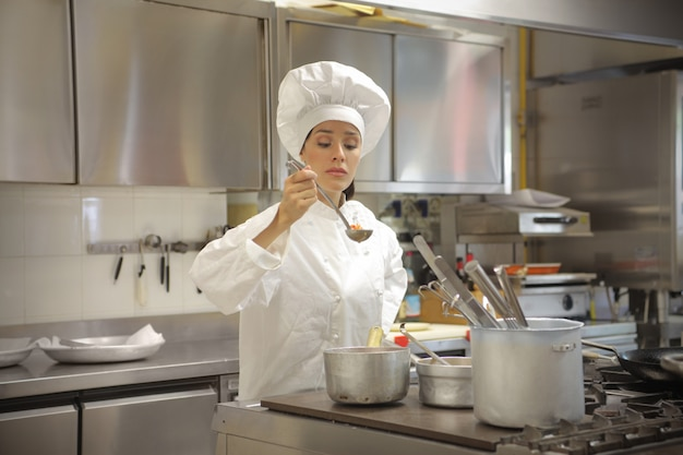 Female chef tasting