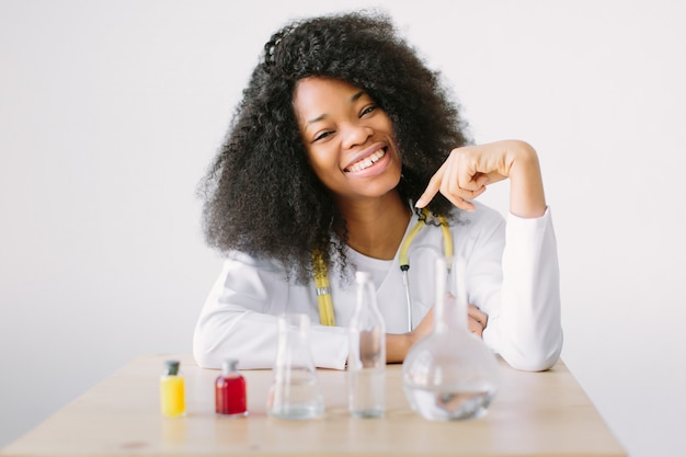 Female chemist in the laboratory of biological. portrait of a young beautiful  girl researcher chemistry student carrying out research in a chemistry lab
