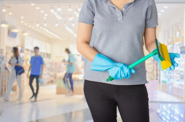 Female cleaning staff in bathroom blurry background