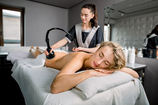 Female client receiving lymphatic drainage massage, anti-cellulite therapy at medical center. hardware cosmetology.