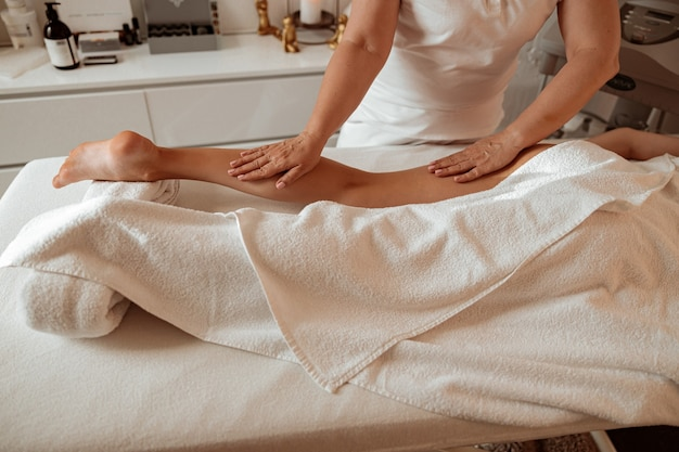 Female client receiving therapeutic massage at wellness center