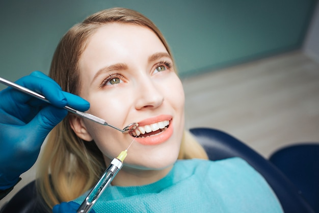 Female client sitting in dentistry chair