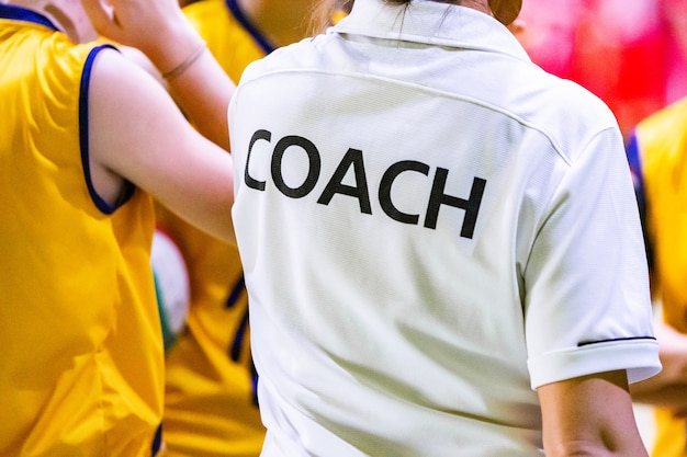 Female coaches in white coach shirt