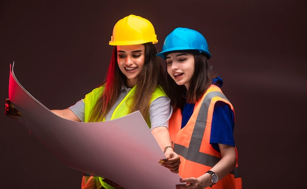 Female construction engineers working together and discussing the project plan.