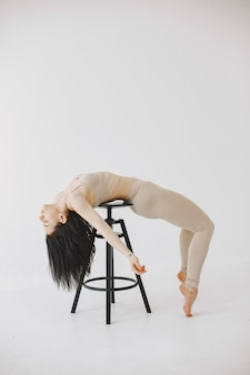 Female contemporary style ballet dancer. woman in a dance studio.