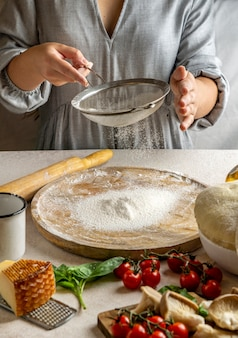 Женщина-повар просеивает муку над деревянной доской для раскатывания теста для пиццы