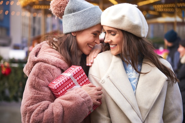 Female couple in love on christmas market