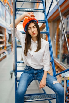 Female customer sitting on stairs, hardware store