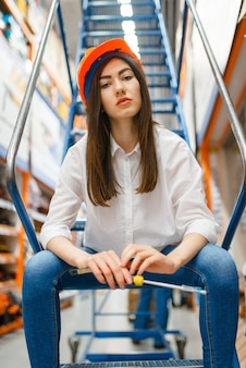 Female customer sitting on stairs