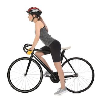 白で自転車に乗る女性サイクリスト