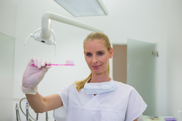 Female dentist holding a toothbrush