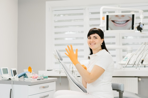 Female dentist in white shirt at workplace