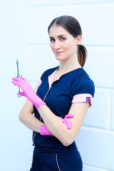 Female dentist with dentistry tools