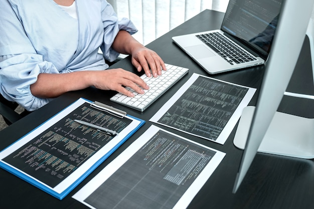 Female developer programmer working on coding program software computer