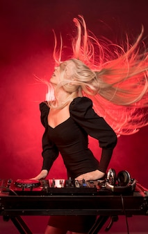 Female at dj console