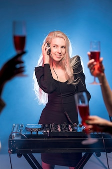 Female at dj mixing console