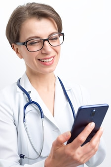 Female doctor advises patient online video chatting.
