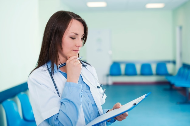 Female doctor checking medical results