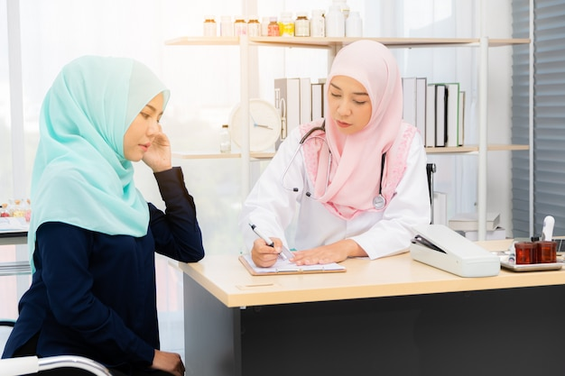 Female doctor giving advice to a female patient.