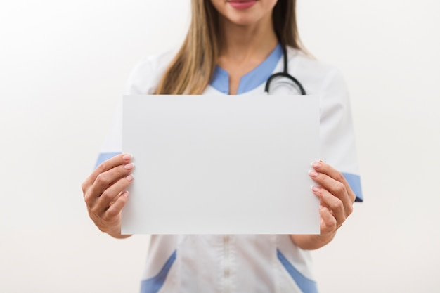 Female doctor hands holding a blank card