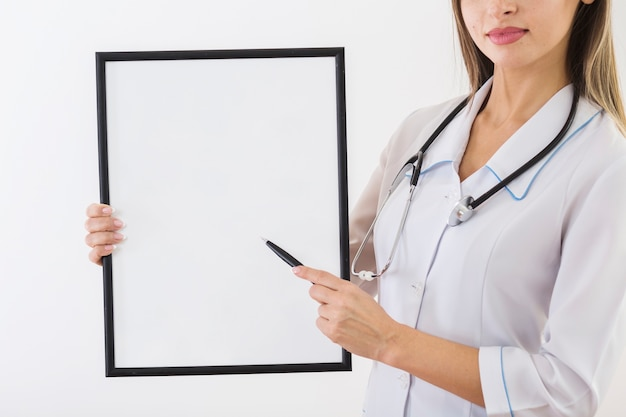 Female doctor holding a blank card