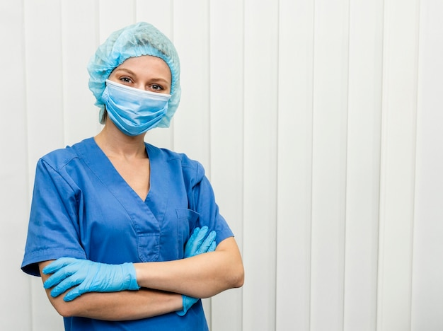 Female doctor at hospital with mask