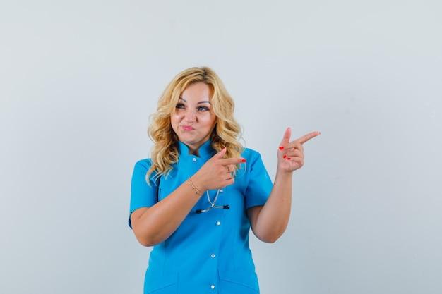 青い制服を着た女医が脇を向いて自信を持って見える